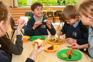 AIP year 6 children enjoying lunch